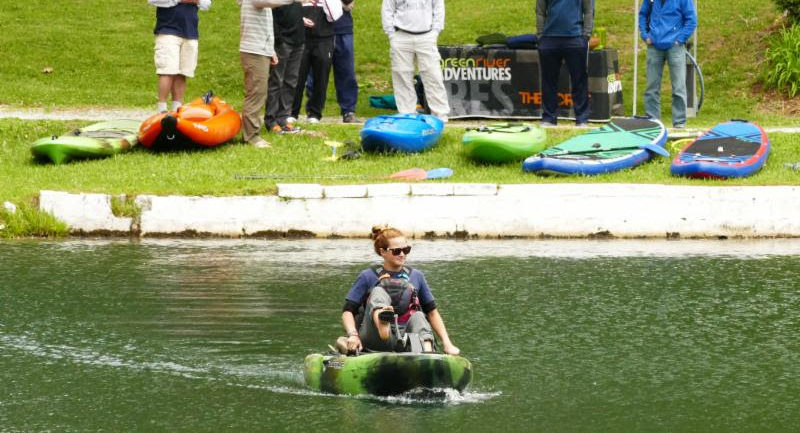 A person kayaking during the Chamber Field Day.