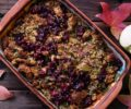 A dish of stuffing on a wooden table for Thanksgiving.