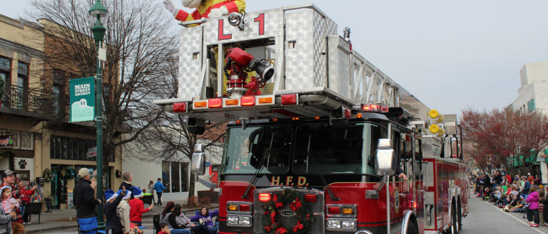 A firetruck and parade marchers in the Hendersonville Christmas Parade.