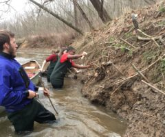 Volunteers for French Broad Riverkeeper applying stakes to combat erosion.