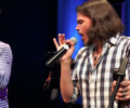 Dustin Brayley and Aaron LaVigne singing during a 2018 performance of Music of the Beatles and Eagles.