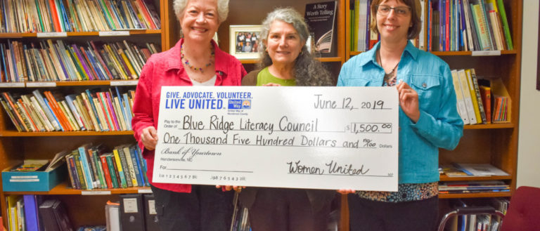 Women United donors presenting a check to a local group.