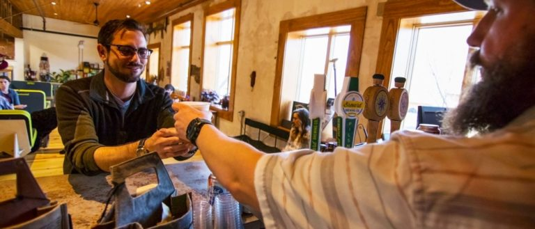 A person being served beer at D.D. Bullwinkel.