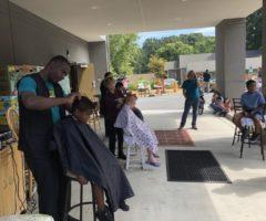 Children getting their hair cut at a Interfaith Assistance Ministry haircut clinic.