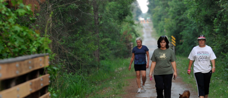 People walking on the Ecusta Trail.